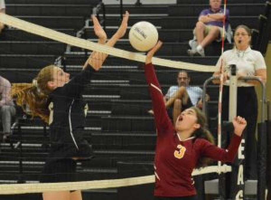 Trumbull's Krystina Schueler looks for a block on St. Joseph's Grace Vocalina. — Andy Hutchison photos