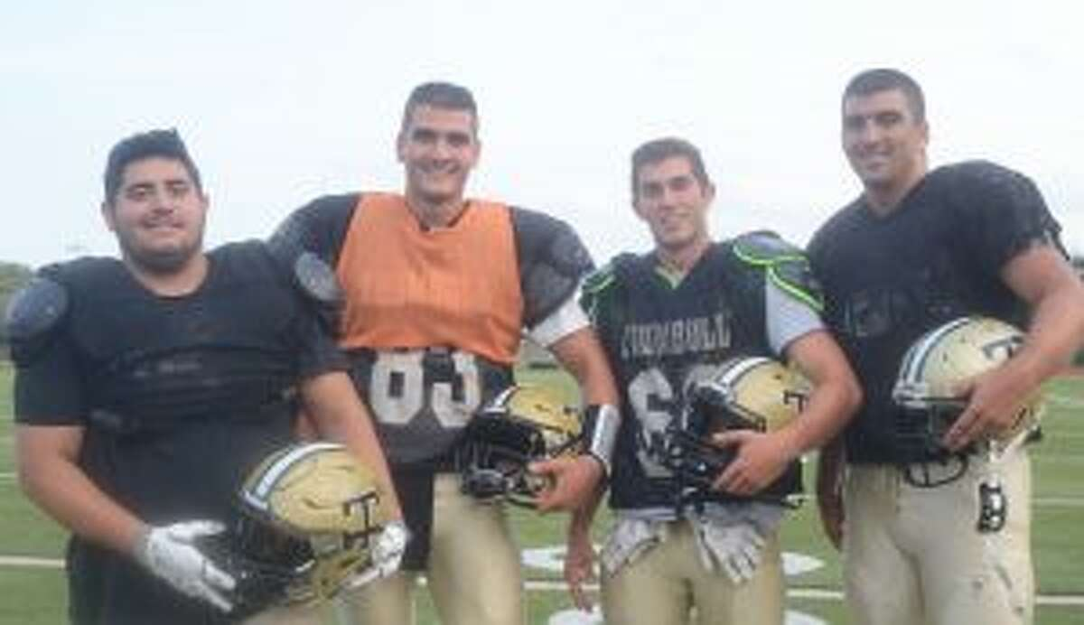 Odai Dayoub, Colton Nicholas, Adam Tolk and Eric Palinkas are Trumbull High captains. - Andy Hutchison photo