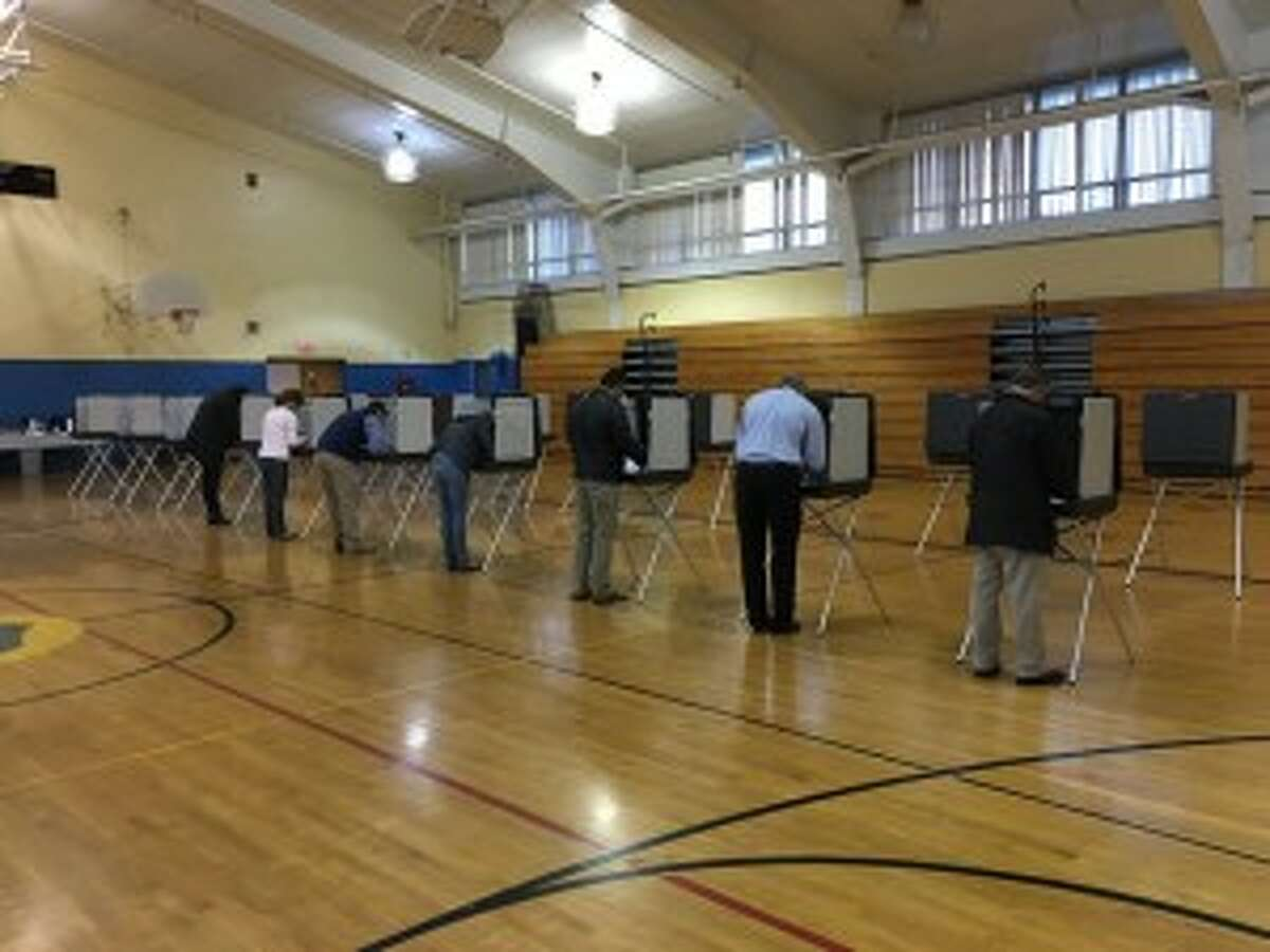 Voters cast their ballots at Madison Middle School, which is where District 3 votes.