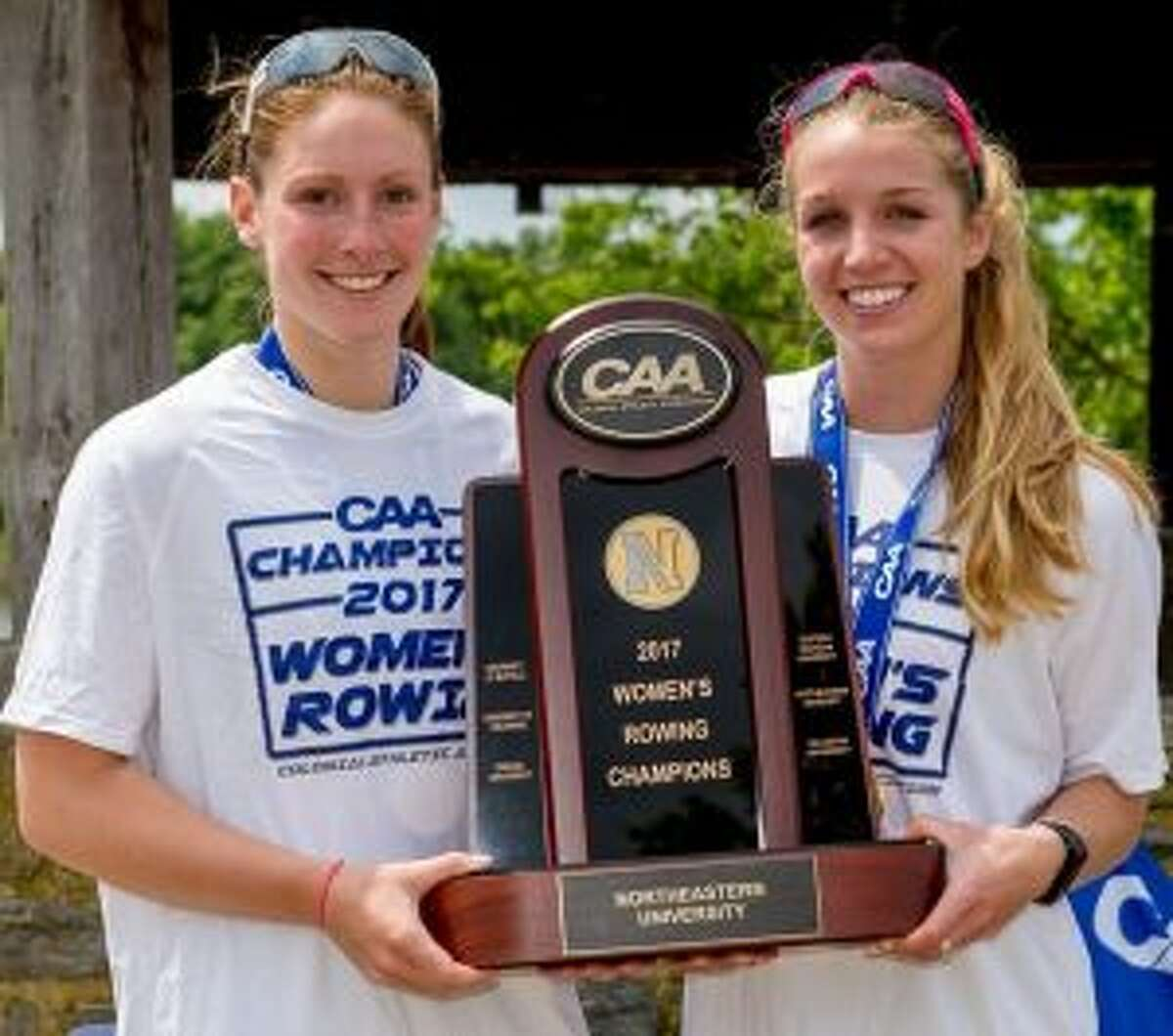 Maggie Walsh (left) and fellow co-captain Heather Foti accept Northeastern's first place trophy at the May 2017 Colonial Athletic Association Championships. It was the fourth straight CAA Championship for coach Joe Wilhelm's Huskies.