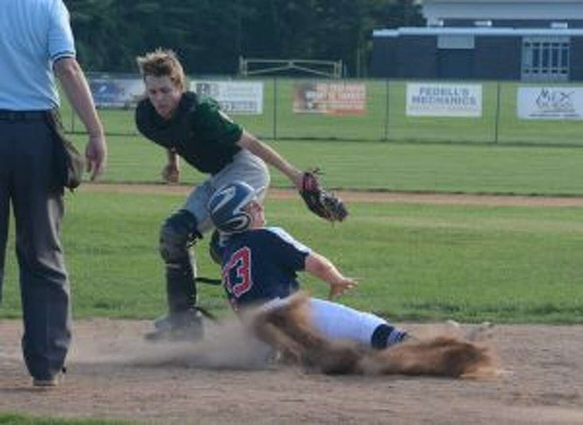 Peter Autuori slides across the plate with a key run.