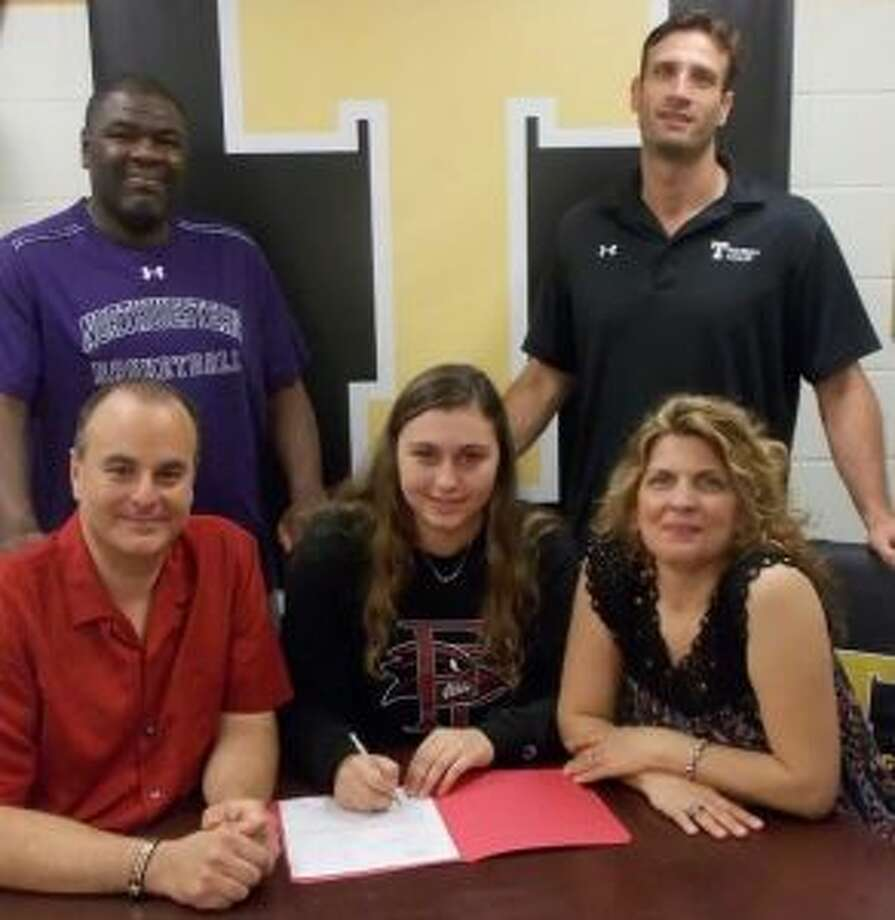 Claudia Tucci is flanked by mom Sandra and dad Anthony when she signed her letter of intent to play at Franklin Pierce University. In the back row are AAU coach Scott Nails and Trumbull High coach Steve Tobitsch.