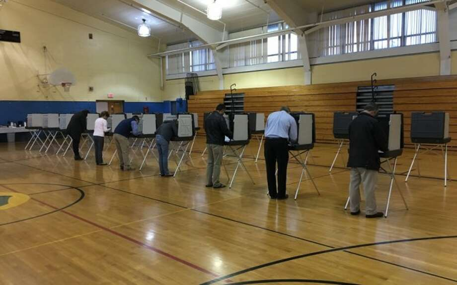 District 3 voterscast their ballots at Madison Middle School in the 2015 municipal election.