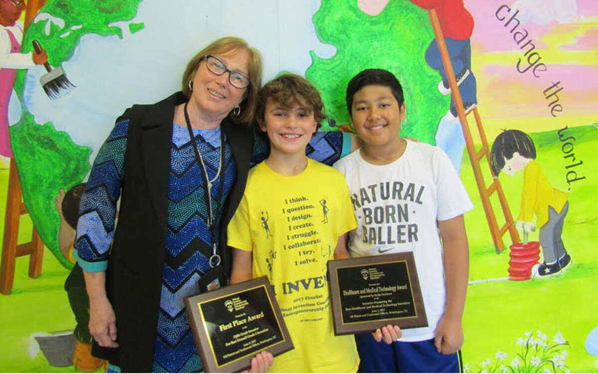 Pictured with Middlebrook School Principal Patricia Frillici are 5th graders Logan Jones and Alex Browne.