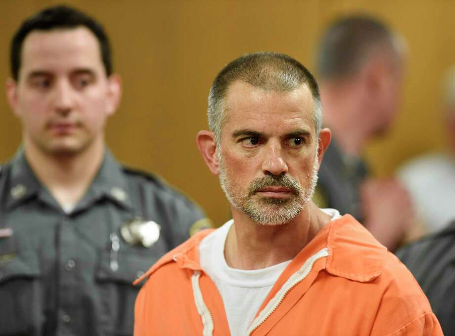 Fotis Dulos is arraigned on charges of tampering with or fabricating physical evidence and first-degree hindering prosecution at Norwalk Superior Court in Norwalk, Conn. Monday, June 3, 2019. Fotis Dulos, and his girlfriend, Michelle C. Troconis, were arrested at an Avon hotel late Saturday night and held on a $500,000 bond for charges of tampering with or fabricating physical evidence and first-degree hindering prosecution. Fotis Dulos is the estranged husband of Jennifer Dulos, the 50-year-old mother of five who has been missing since May 24. (Tyler Sizemore/Hearst Connecticut Media via AP, Pool) Photo: Tyler Sizemore / Associated Press / Greenwich Time