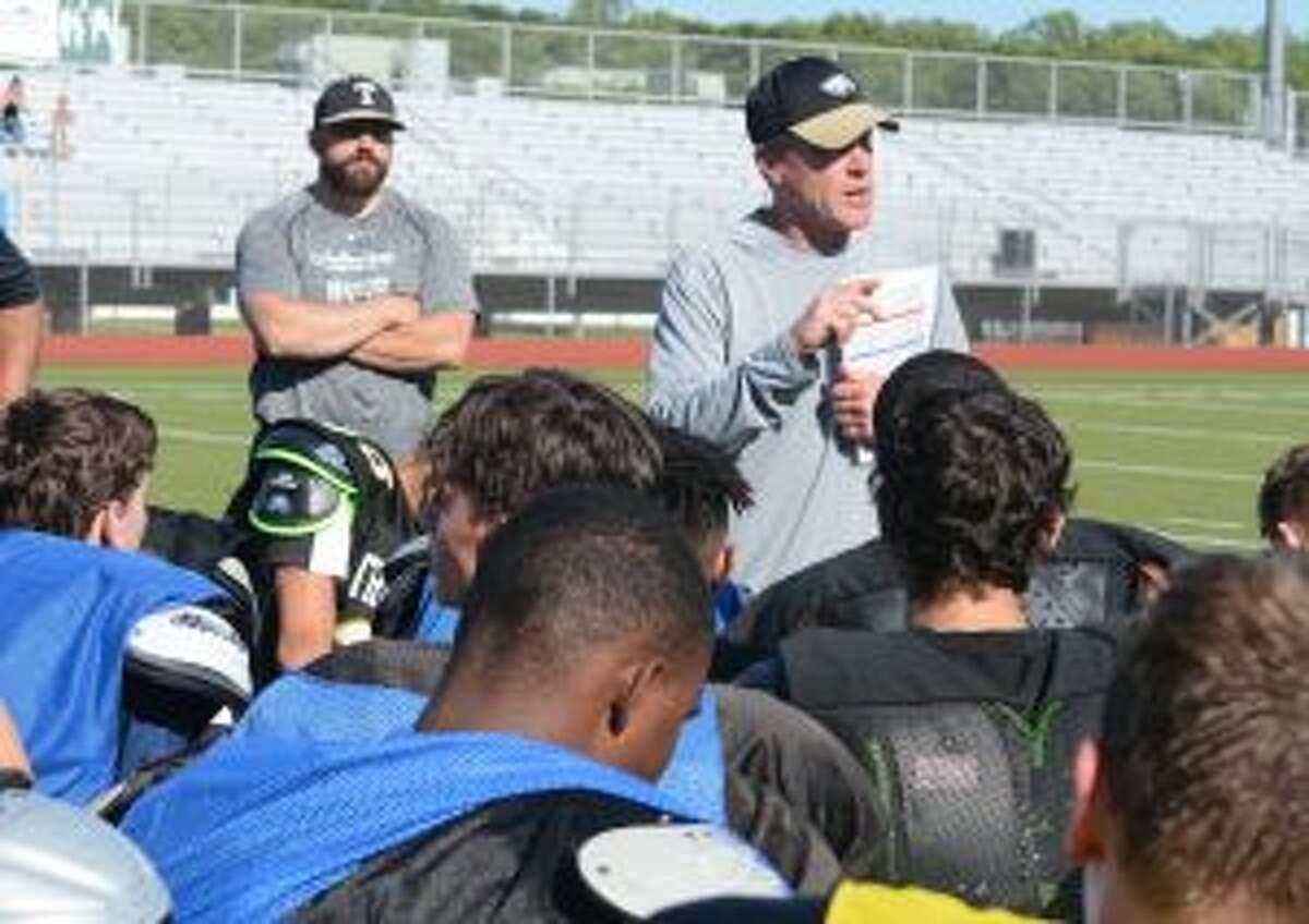 Trumbull coach Bob Maffei speaks to his team.