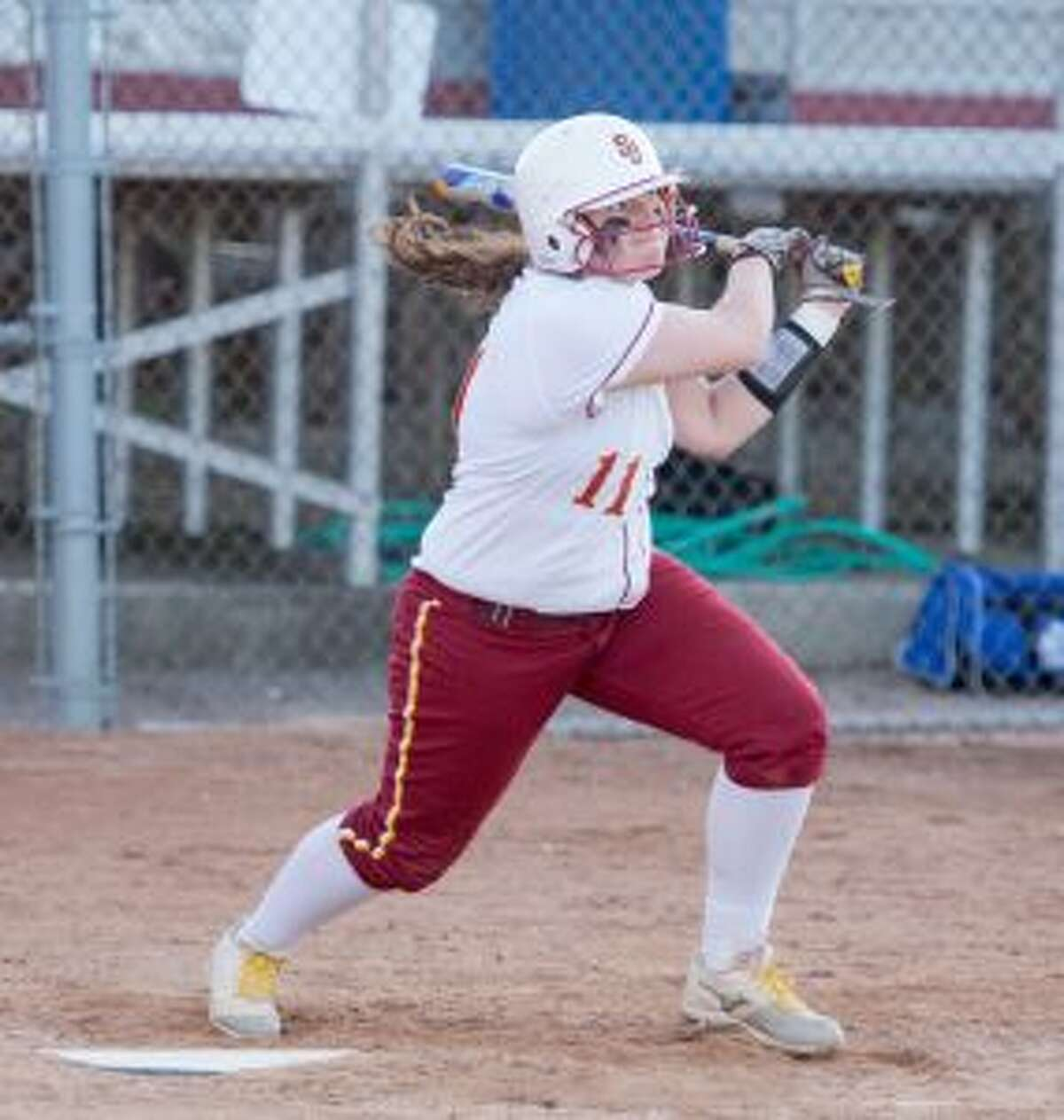 Jovanna Hillman follows through on her swing when the senior homered in the third inning to tie the game. - David G. Whitham photos