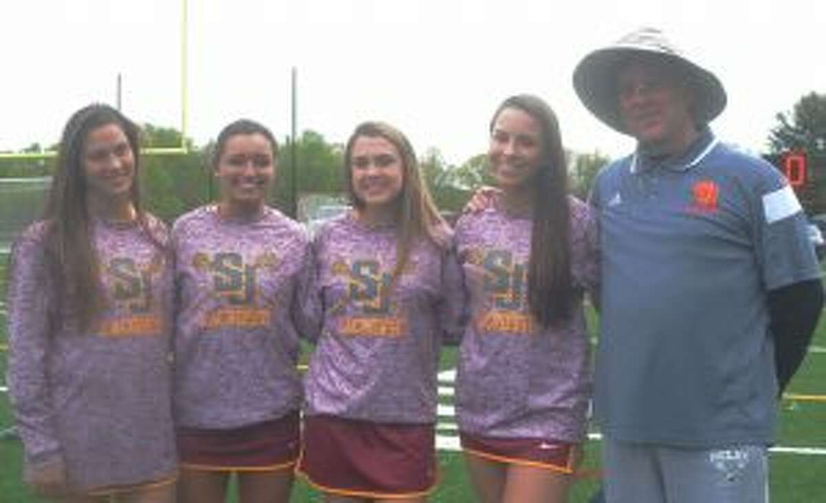 St. Joseph girls lacrosse coach Leeland Gray is joined by daughter and Cadet sophomore Jettke Gray along with seniors Mikala Trafecante, Amanda Lopez and Kate O'Dea.