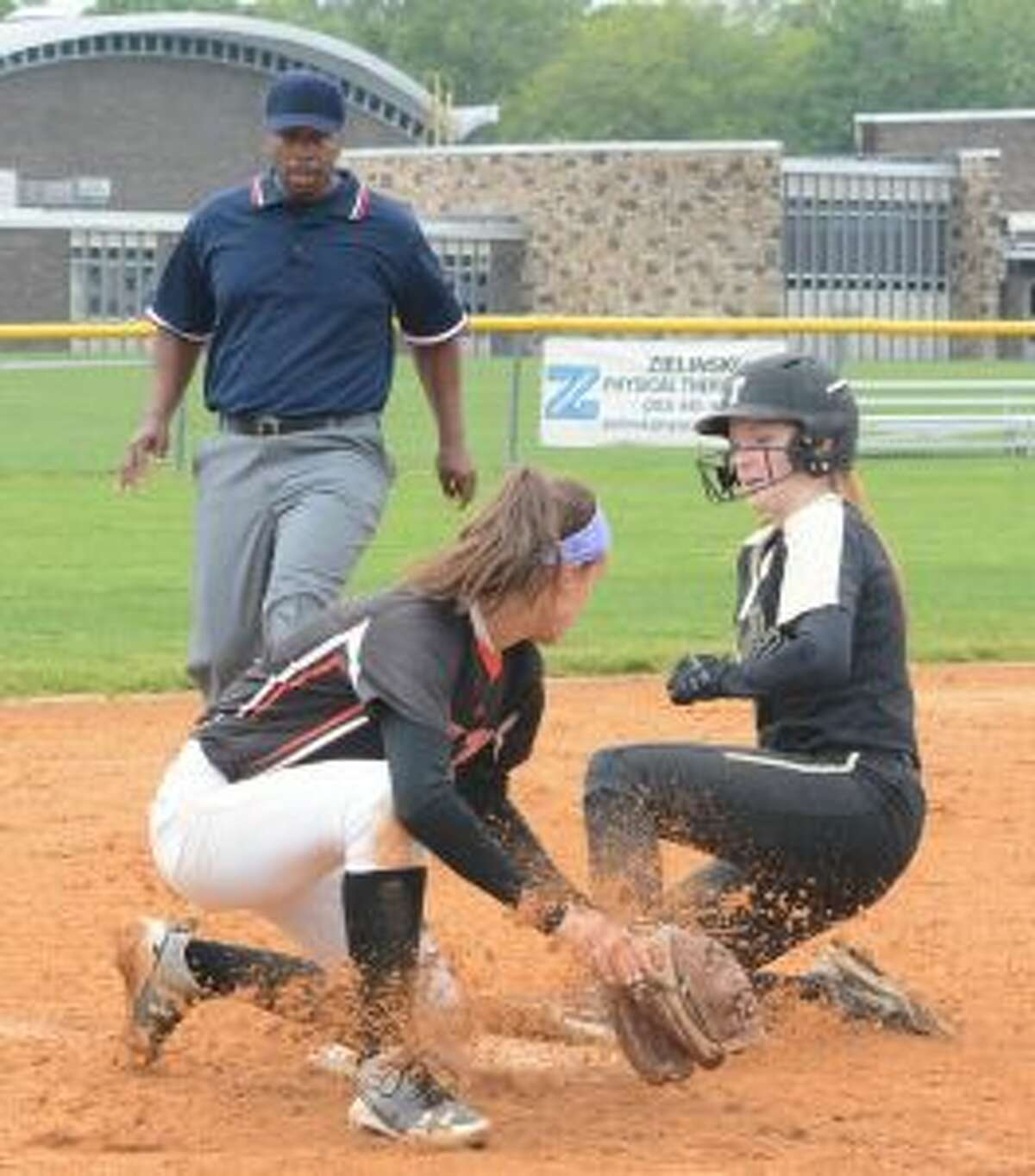 Taylor Brown slides safely into third base. - Andy Hutchison photo
