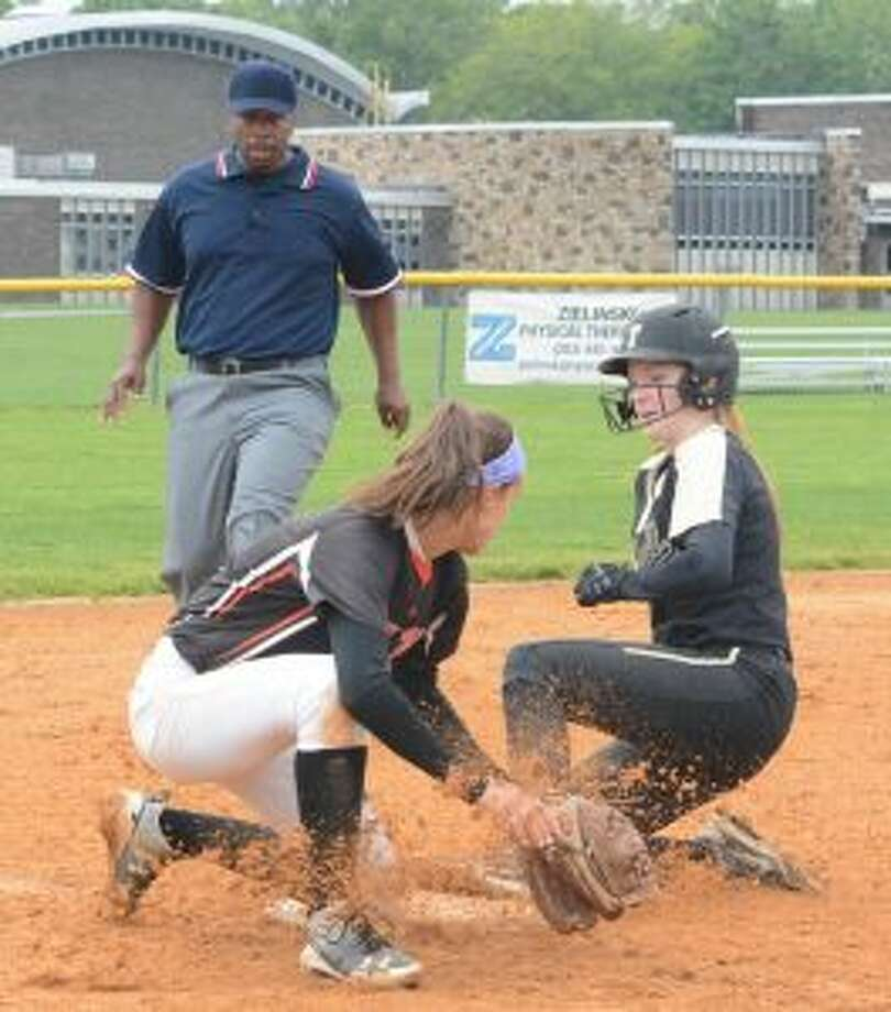 Taylor Brown slides safely into third base. — Andy Hutchison photo