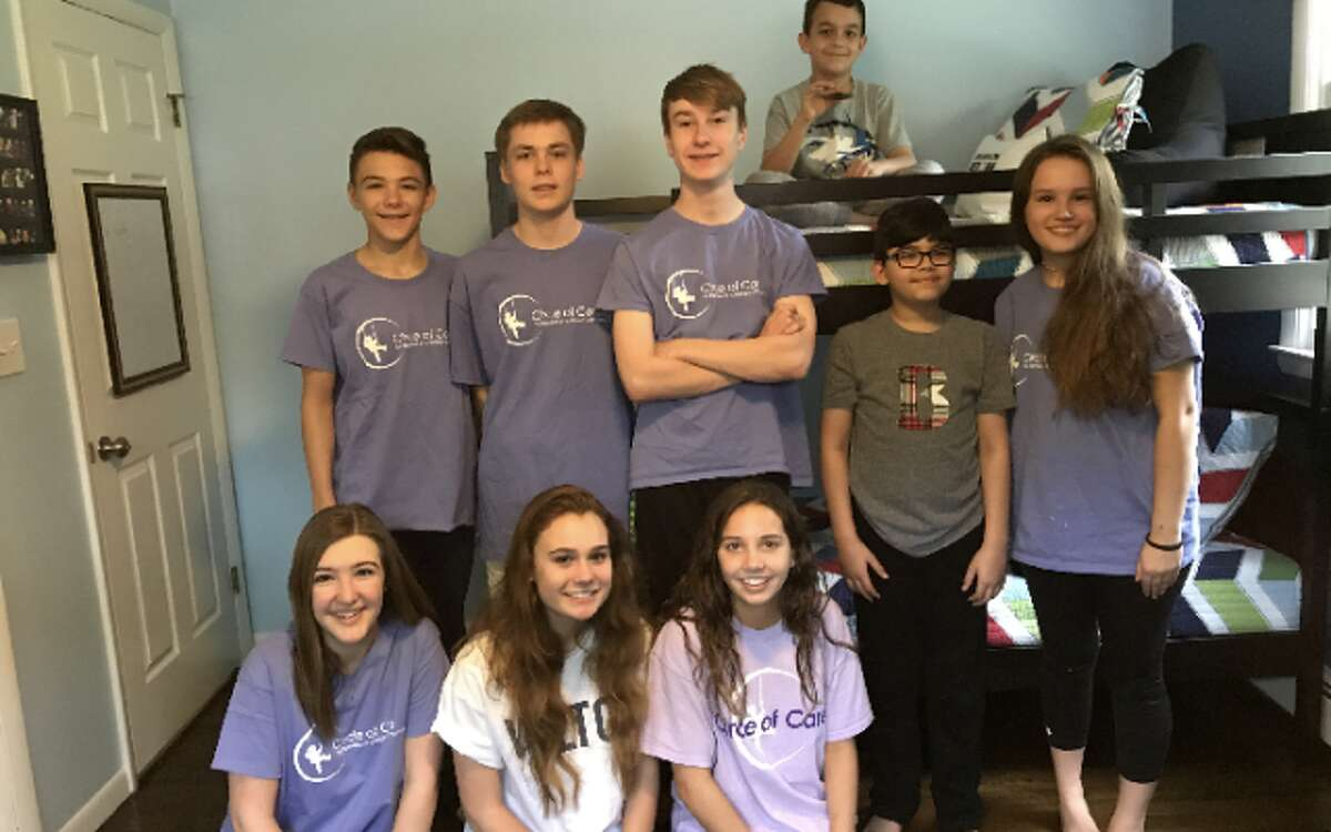 Bernardo, second from right, and his brother Sebastian, on bed, recently received a gaming-themed bedroom makeover from Wilton High School students, from left, top row: Isaac Quantock, Connor Uitterdijk, Erynn Fray and Emma Snyder; bottom row: Alex Buse, Allie Courtney and Katie Buse in their new bedroom. - Contributed photo