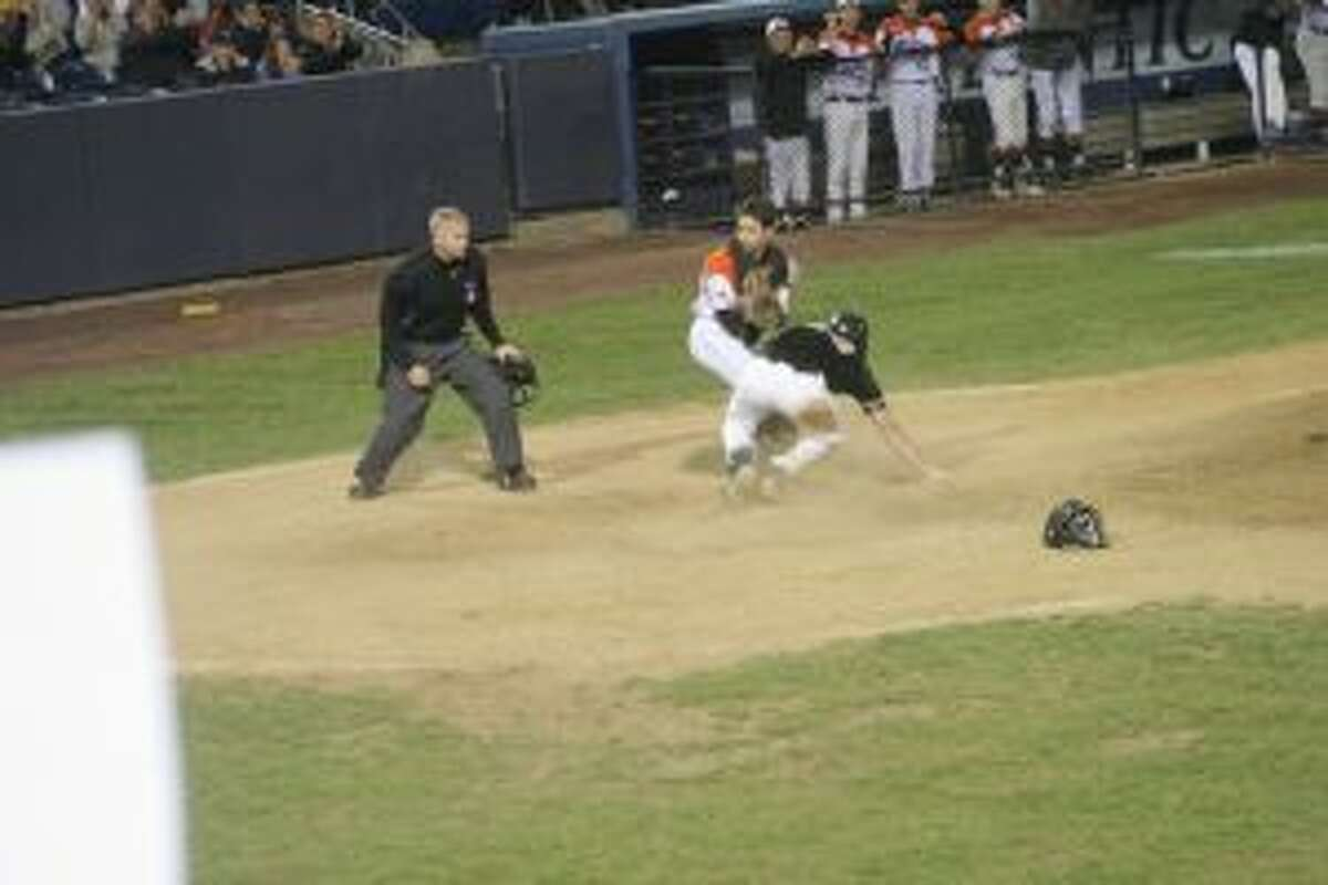 Ridgefield catcher makes the tag and awaits the out call in the fourth inning.