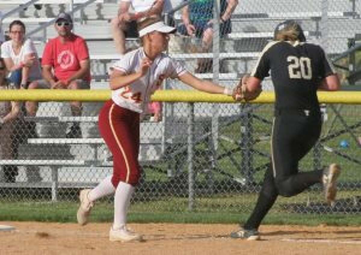 Cadet first baseman Melissa Bike comes off the bag to make the tag on Ally Szabo.