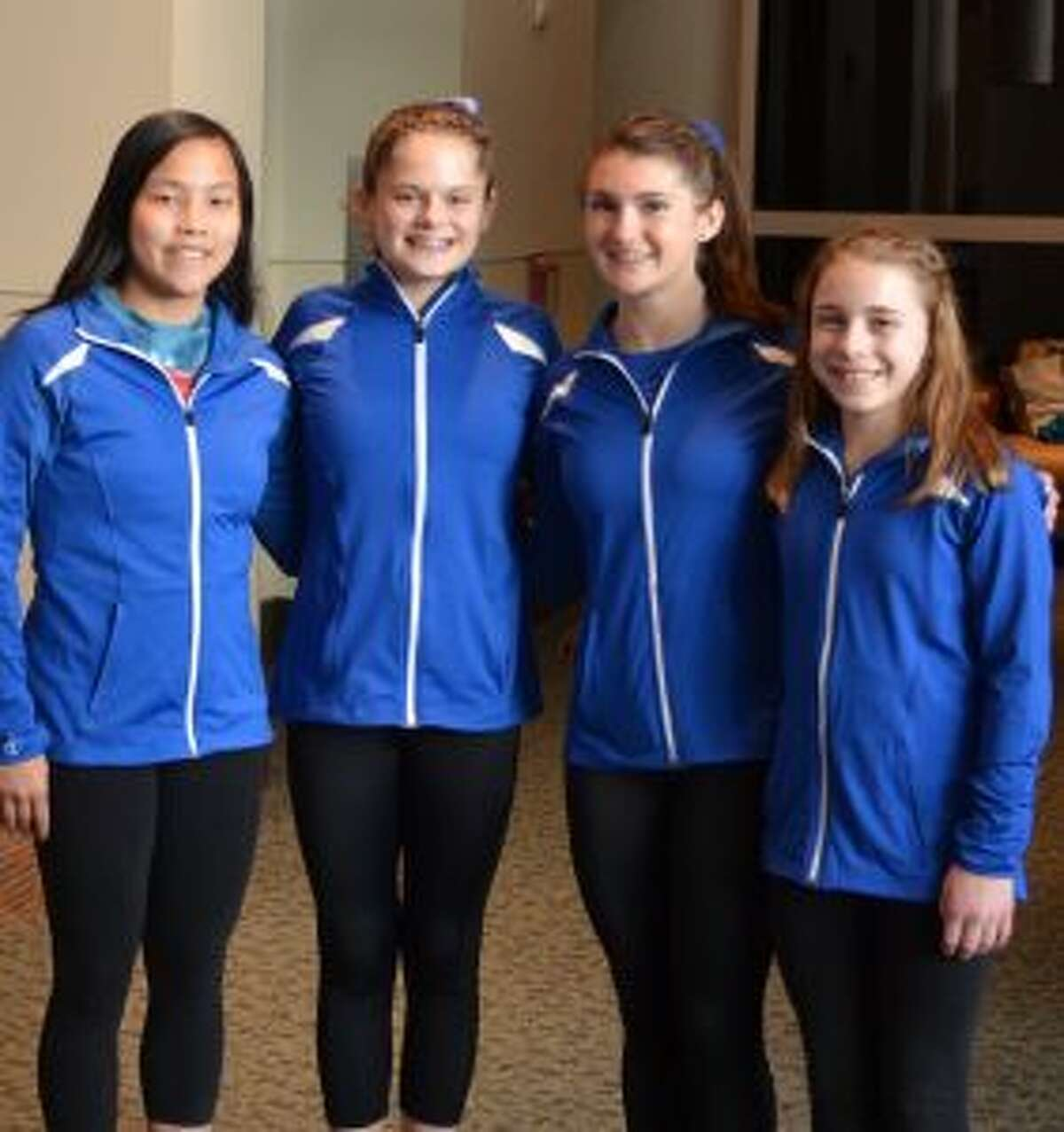 Next Dimension Gymnasts of Trumbull had four state gymnasts qualify to represent Connecticut at the Regional Championships - Samantha Markland, Macarthy Keane, Merritt Stevenson and Caitlin Vozzella.