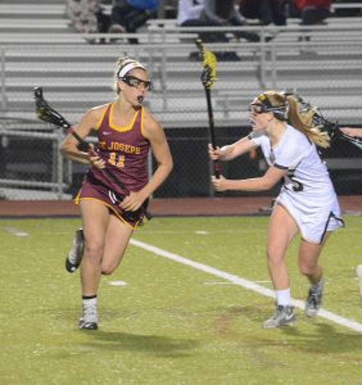 St. Joseph's Kate Condron is marked by Trumbull High's Courtney Lynch. - Andy Hutchison photo