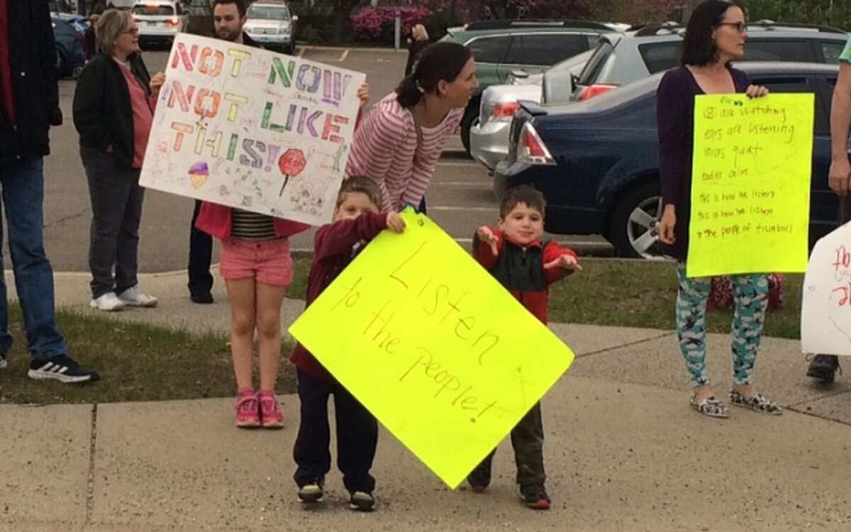 About 70 residents turned up an hour before the Town Council meeting to protest the community center and the proposed sale of six town-owned properties.