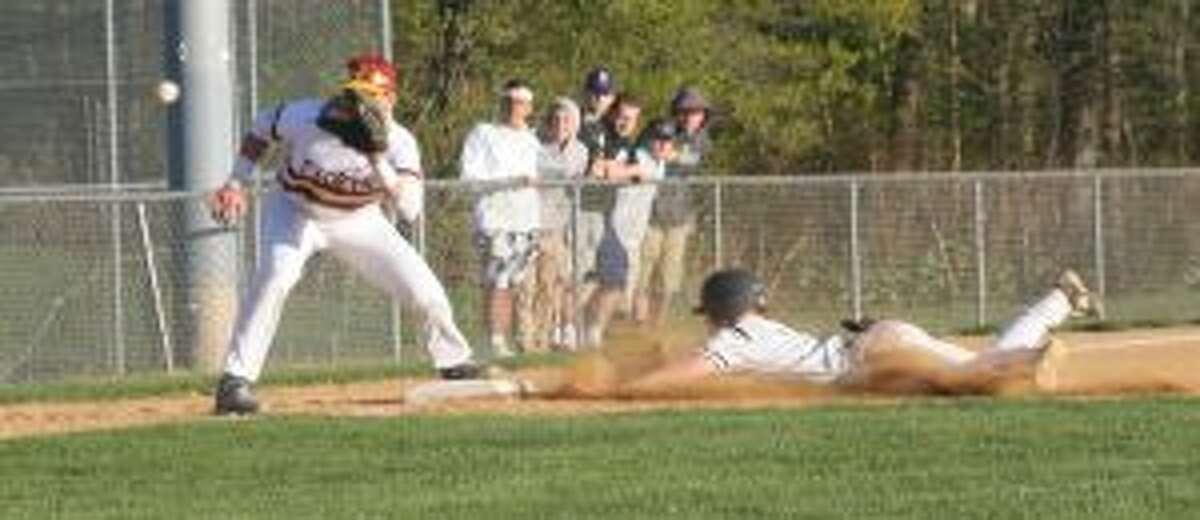 Sam Montalvo slides safely into third base as St. Joseph's Charlie Pagliarini waits for the throw. - Bill Bloxsom photo