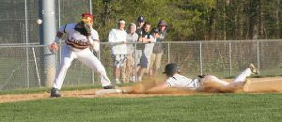 Sam Montalvo slides safely into third base as St. Joseph's Charlie Pagliarini waits for the throw. — Bill Bloxsom photo