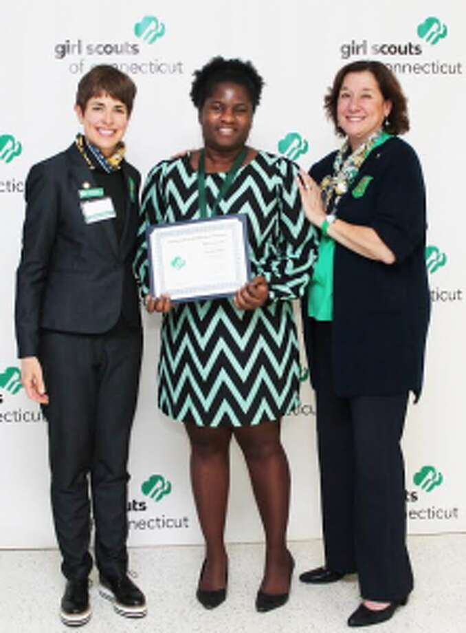 Trumbull resident Claudine Phaire, center, receives a national appreciation award from state President Trish Bowen and CEO Mary Barnaby. — Submitted