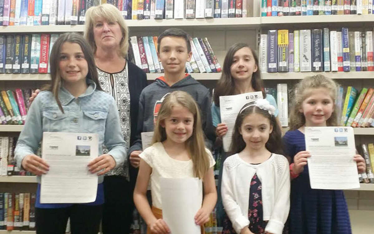 Essay contest winners pose with OBOT committee member Diane Strever: Ava Meagher, Bobby Welch, Abigail Horan, Sophia Pucci, Guliana Clericuzio, and Maura Brunt.