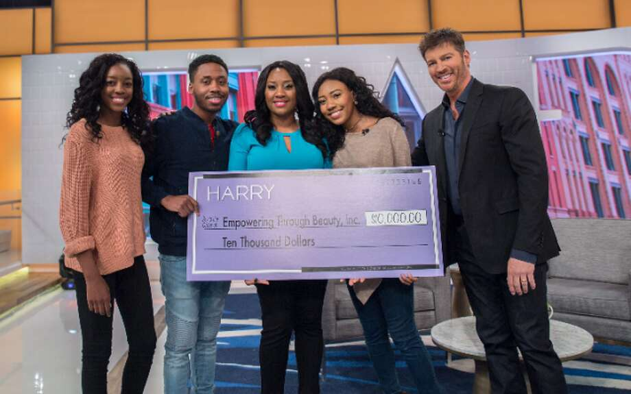 Tanisha Akinloye with her children on stage with Harry Connick Jr. — Submitted photo