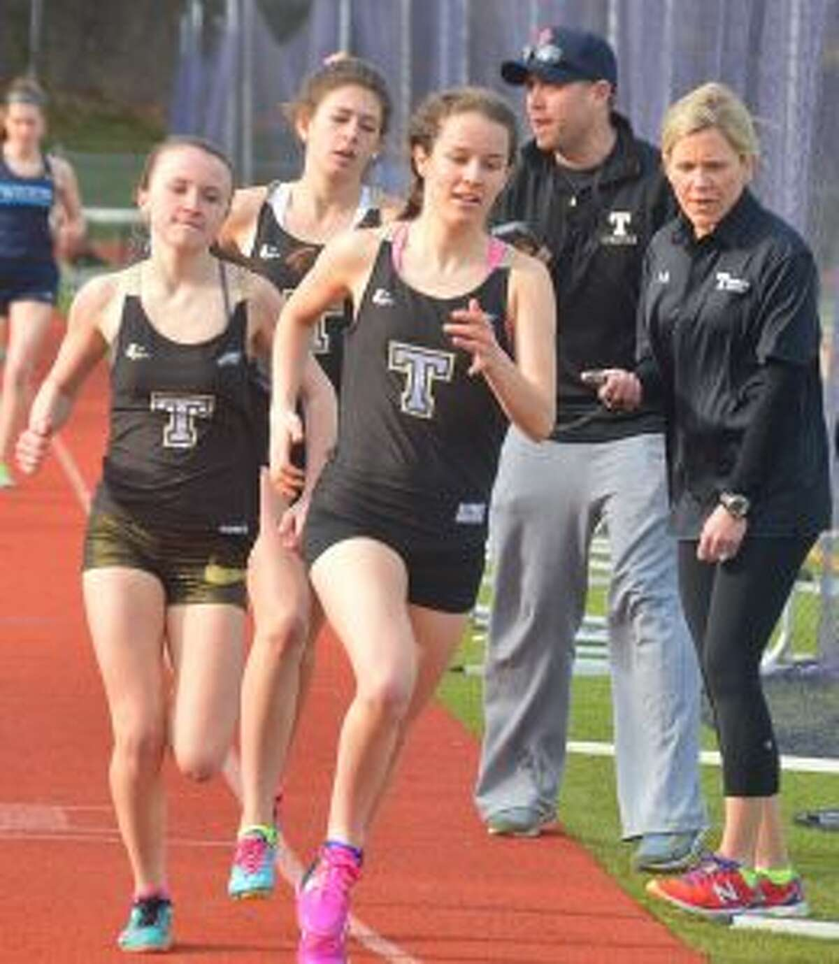Margaret LoSchiavo won the 3200 meter run in a personal best of 12:12, Ashley Storino placed first in the 1600 meter run at 5:26 and Kate Romanchick took the win in the 800 meter run in 2:30. Looking on are coaches Jim McCaffery and Carrie Hall.