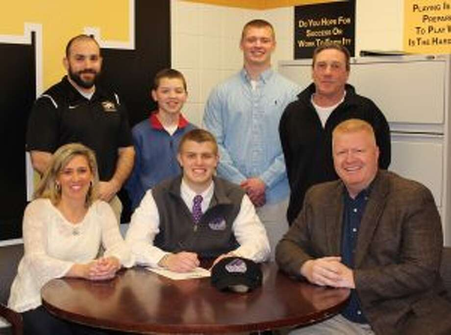Ryan Kelly has signed to play football at Stonehill College. Pictured (front row) are Monica Kelly (mom), Ryan Kelly and John Kelly (dad); (second row) Trumbull assistant coach Gene Cellini, brothers Danny and Jack Kelly and Trumbull head coach Bob Maffei.