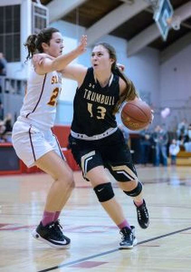 Trumbull's Claudia Tucci (13) scored 25 points in the win over Wilton. — David G. Whitham photo