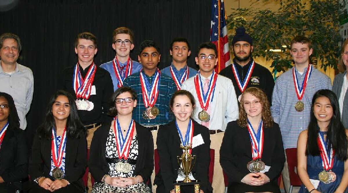 Trumbull Academic Decathlon team members with their medals from the state competition. In back, from left, co-coach Dean Pelligra, Vittorio Colicci, Connor Flaherty, Lalith Gannavaram, Viraj Dongaonkar, Ishan Negi, Harshpreet Singh, Robert Foley, and co-coach Sara Ellis. In front, Daejah Woolery, Saloni Shah, Sophie Calandro, Alexandra Dima, Elisabeth Stankevitz, and Claudia Zhang.