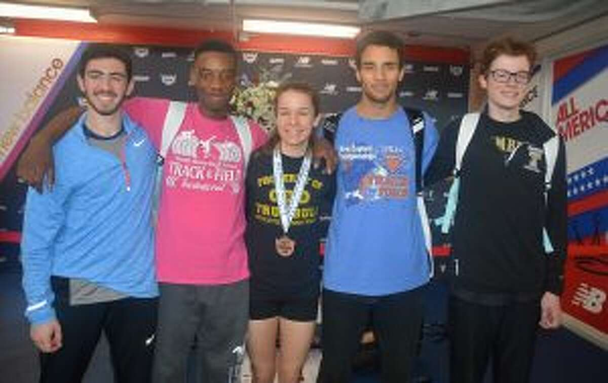 Tyler Rubush, Nigel Hayes, Kate Romanchick, Tyler Gleen and Colin McLevy celebrate after medaling at the New Balance Indoor Track Nationals.