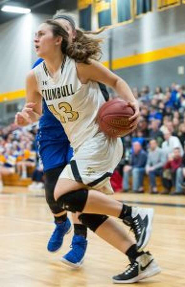 Claudia Tucci drives the baseline for a bucket to give Trumbull a 33-32 lead. — David G. Whitham photos