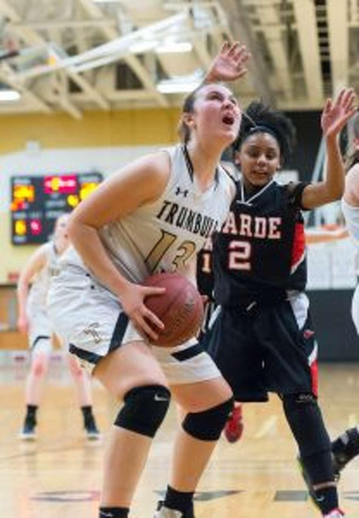 Trumbull's Claudia Tucci gets to the basket, as Warde's Deja Polk defends. - David G. Whitham photos