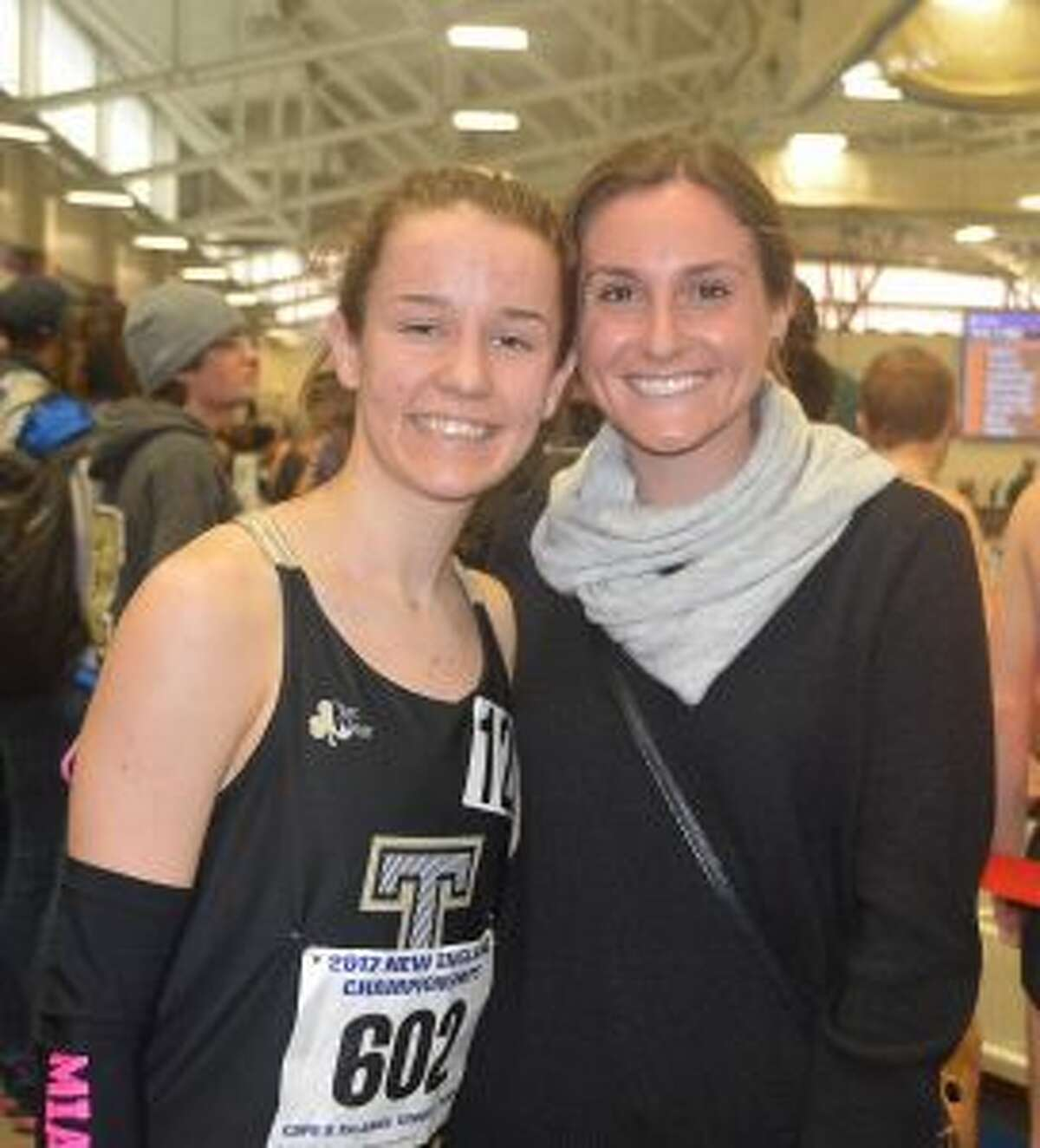 Kate Romanchick is congratulated by previous record holder Danielle Klein after setting a school record in the 3200 at the New England Championships.