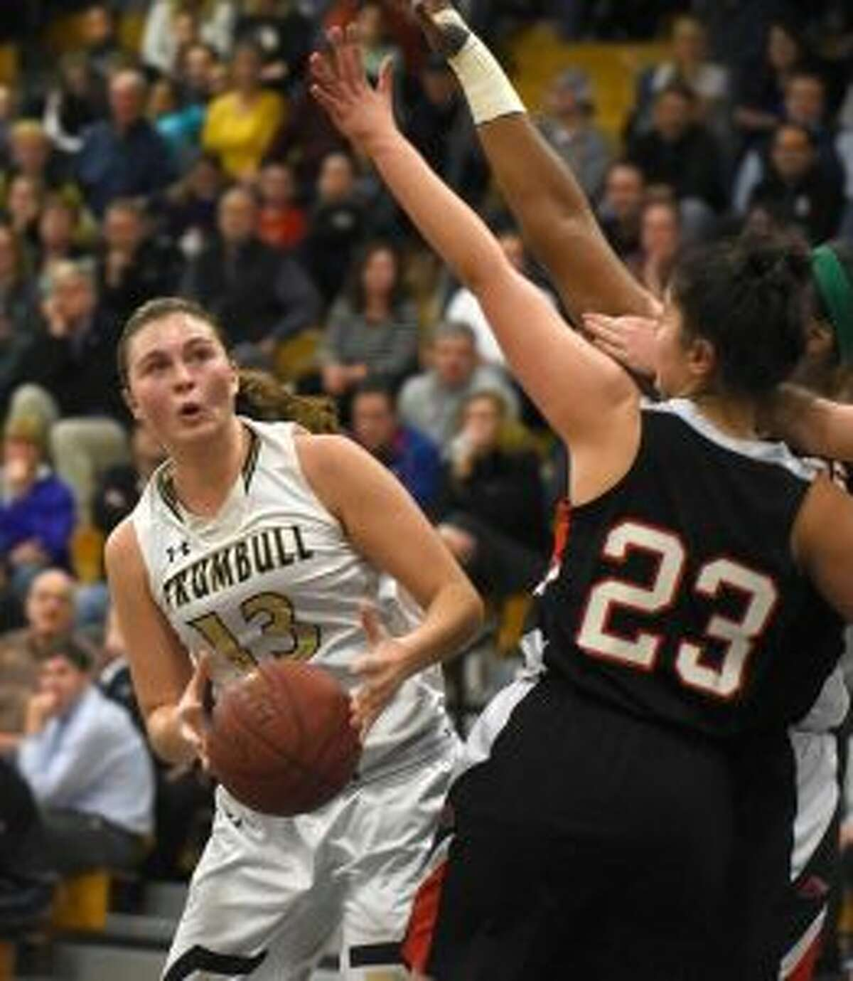 Claudia Tucci looks for room to shoot in Trumbull's overtime thriller with Warde. - Dave Stewart photo