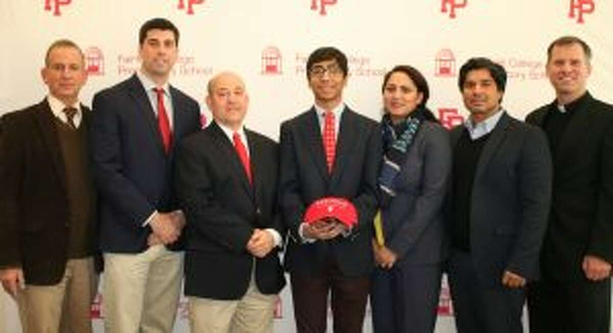 Fairfield Prep Principal Dr. Robert Perrotta; Athletic Director Tom Curran; head wrestling coach Ned Dwelle; Kasim Khan; parents Uswah and Ayub Khan; and Pres. Rev. Tom Simisky, S.J. gather after Khan committed to wrestle at Wesleyan University.