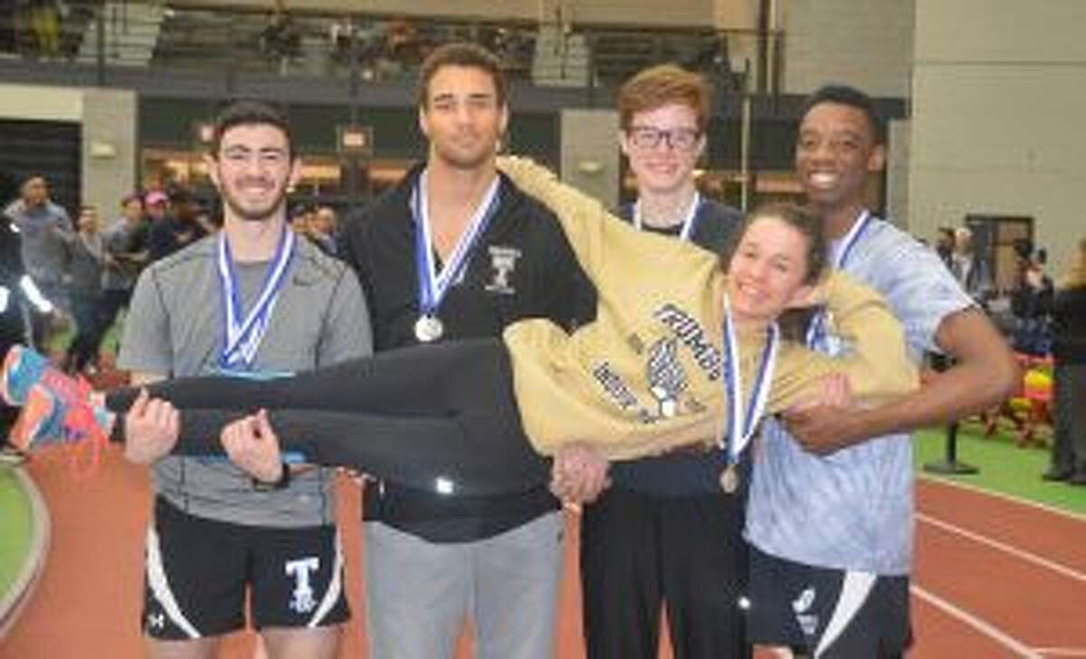 Trumbull High Class LL state champions Tyler Rubish, Tyler Gleen, Colin McLevy and Nigel Hayes lift fellow title winner Kate Romanchick in celebration of their first-place finishes.