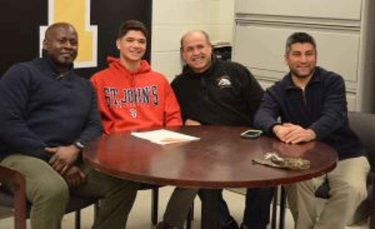 Trumbull High's Chris Lancia is joined by his coaches, Floyd Neal, Sebastian Gangemi and Sil Vitiello after signing to play soccer at St. John's University.
