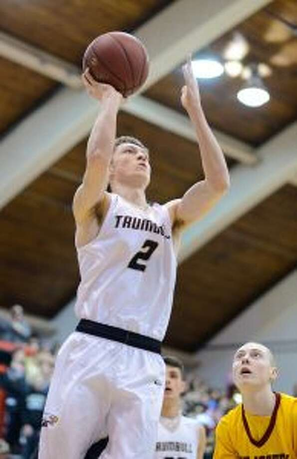 Jack Lynch scored six of his 15 points in the fourth quarter for the Eagles. — David G. Whitham photos