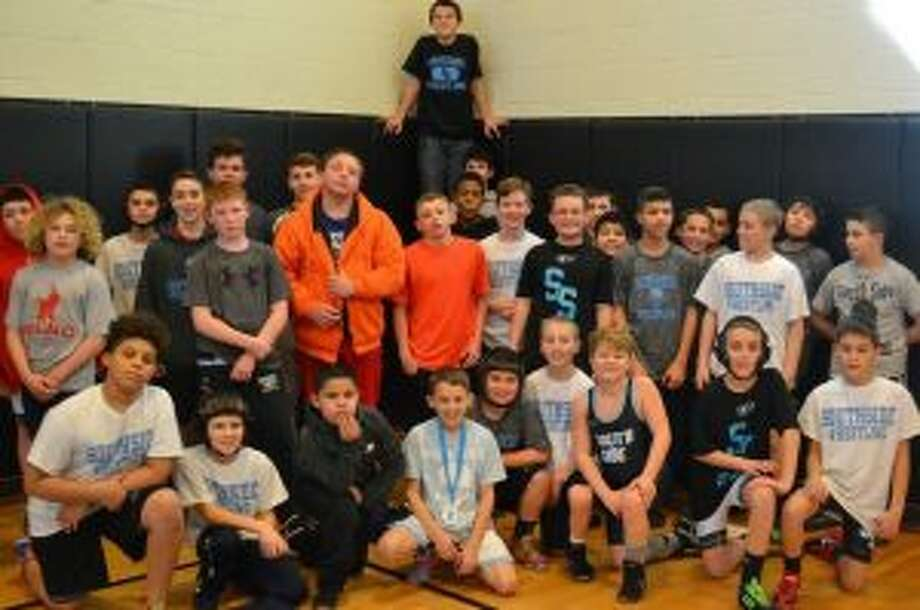 South Side brought home 10 titles from its Scuffle Wrestling Tournament.
