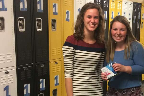 Lydia Krahn and Emily Fox decorate Trumbull High lockers to remind their fellow students that #EveryoneKnowsSomeone who has been impacted by substance abuse and addiction. The campaign was launched by TPAUD, the THS Youth2Youth Club, and The C.A.R.E.S. Group.