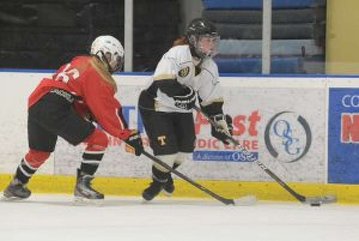 Erin Owens handles the puck. She had a goal and three assists. - Andy Hutchison photo