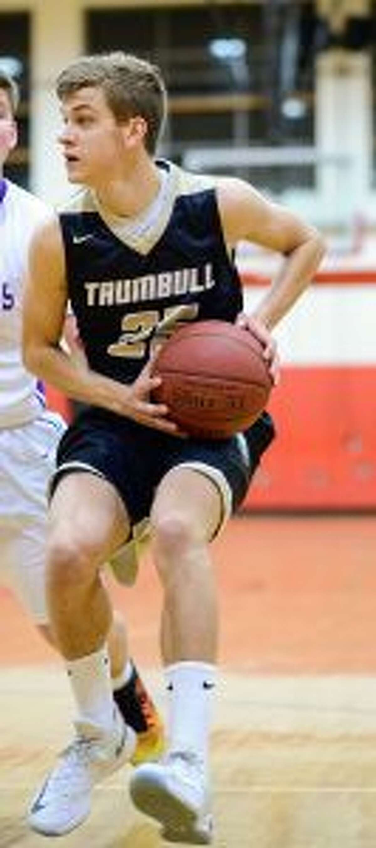 Trumbull High's J.J. Pfohl beat the buzzer with a basket to give his Eagles the win. - David G. Whitham photo