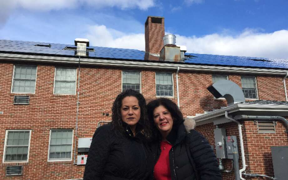 Stern Village Congregate Manager Daisy Torres and Executive Director Harriet Polansky recently unveiled the solar panels atop the Congregate building. The panels should save about $4,600 annually on energy costs.