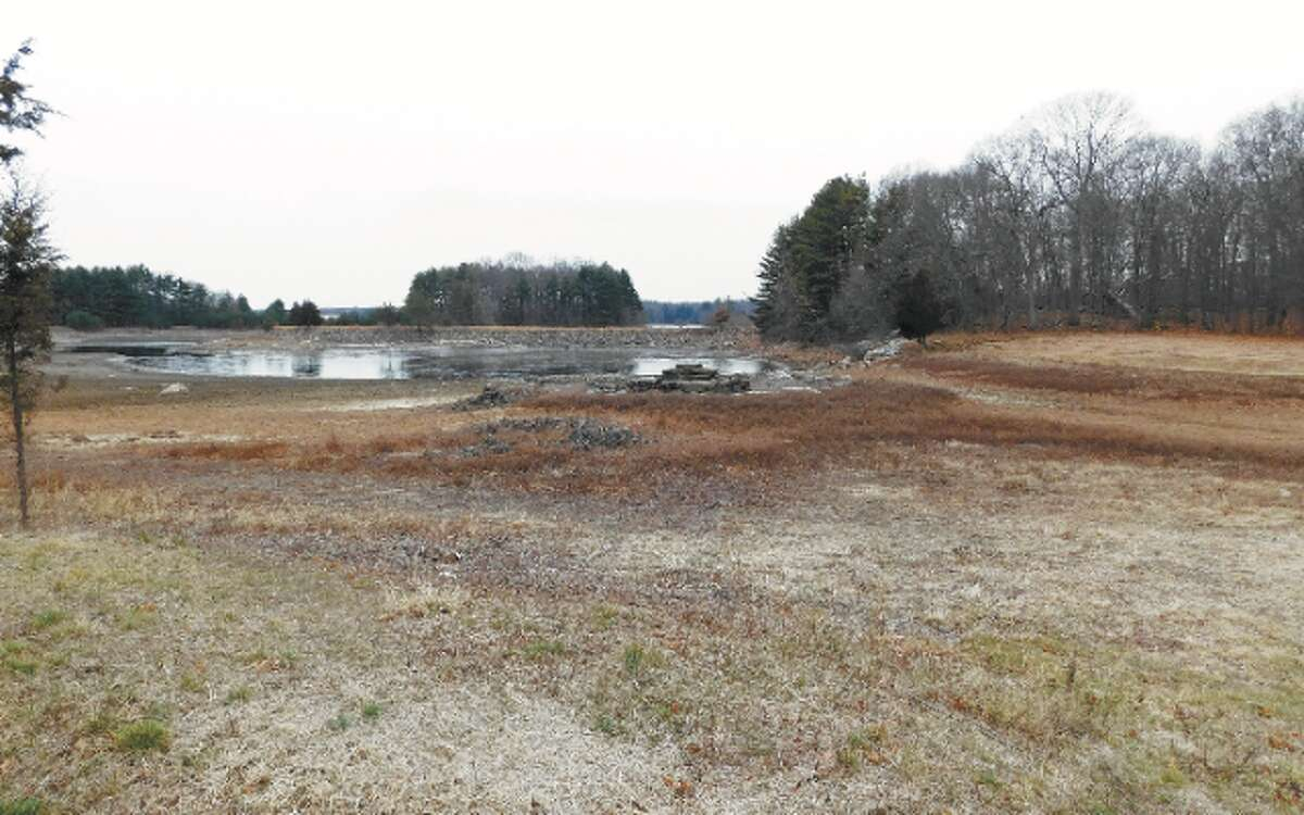 The ongoing drought has lowered reservoir levels in the Aquarion Water Co. system serving Fairfield County, including at Trap Falls Reservoir in Shelton, as shown here. - Brad Durrell photo