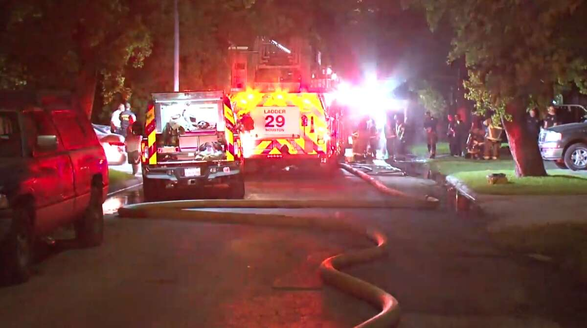 Houston firefighters late Monday clear the scene of house fire in southeast Houston, believed to be caused by a candle. A firefighter was injured while battle the blaze, authorities said. The homeowner safely got his family out.