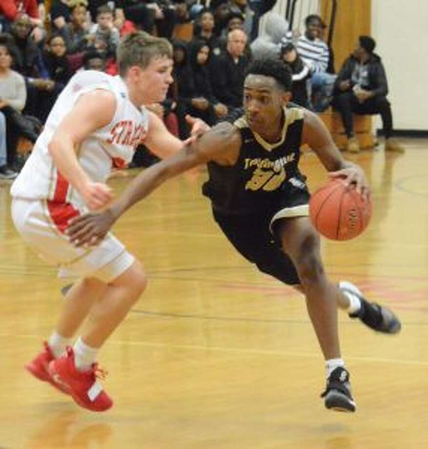 Timmond Williams drives to the basket. — Andy Hutchison photos