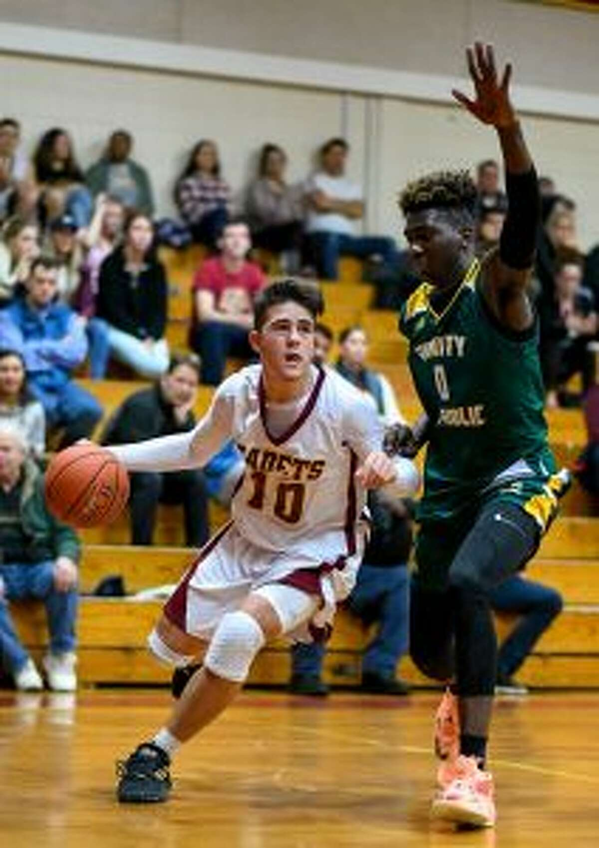 Paul Fabbri scored 14 points for the Cadets, with a pair of 3-point baskets.