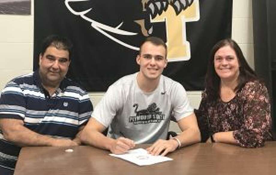 Chris Briganti signs his letter of intent with mom Colleen and dad Dave looking on.