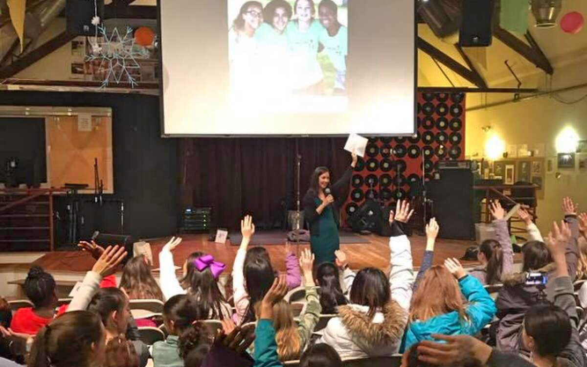 Ashley Gaudiano asks for a show of hands of who in the audience has ever failed at something during her talk at the LiveGirl Live Kind Summit. - Submitted photo