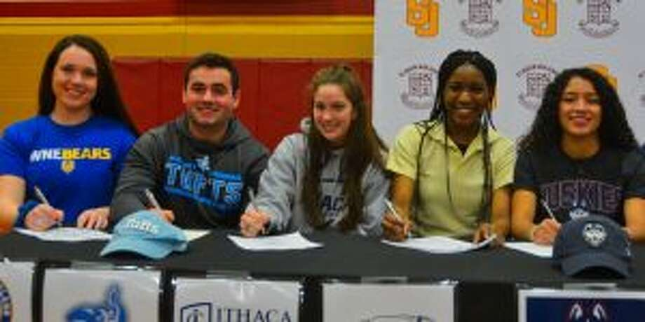 Emma Elrod, Jim Evans, Jettke Gray, Olivia Johnson and Jessica Mazo put pen to paper.